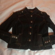 """Gently Pre-Loved Black Military Look Jean Jacket M Old Navy black gently pre-loved military style cropped jean jacket size medium. >RUNS SMALL. Dark wash with minimal wear it is soft and has no fading.  It measures 18"""" across armpits lying down (36"""" chest) and is 21"""" long. Measure a jacket you have that fits to compare. Made in India of 98 pct cotton and 2 pct spandex with silver logo buttons and epaulets.  Perfect on-trend piece with the military look.  Comes from a nonsmoking no pet home…"""