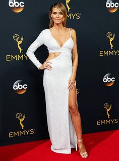 Heidi Klum wearing a Michael Kors custom white diamond pavé silk-crêpe cutout gown at the 2016 Emmy Awards.