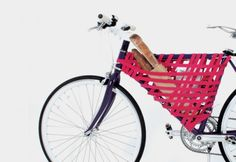 Create some (unusual) bike storage in the main triangle of your bike, using straps.
