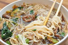 pho for you -- rice noodles, beef stock,  soy sauce, grated ginger, mushrooms, garlic, white onion, baby bok choy, thinkly sliced strip steak, scallions, sesame oil, shredded basil