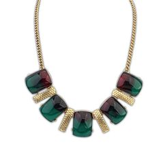 Coco Elegance necklace £8.00  This glamorous necklace is a picture of style and fashion. Featuring four gold strips with a net pattern engraved into them, separating five large gemstones. The larger gemstones are what really attract an audience, with their elegant peacock colours of red into green, a great necklace for an evening out but can be used everyday.