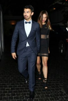 Dressed up in a suit and bow tie, Joe Jonas goes out with his girlfriend Blanda Eggenschwiler in West Hollywood.