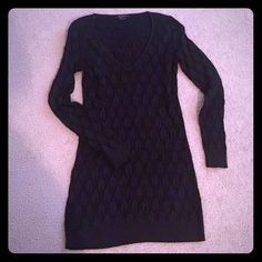 Black sweater tunic Long sleeves, V neck black sweater tunic with silver shimmer all over. Perfect amount of holiday shimmer.  Gorgeous for your holiday party, pair it with a pair of leather leggings or red leggings; perfect with tall boots, booties or heels.  Make your jeans a bit more festive with this awesome tunic!  You'll love how versatile this piece is ( I think this can fit a medium or large)  Tags:   sweaters   Tops  tunic Christmas ECI Sweaters V-Necks