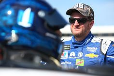 Dale Earnhardt Jr. Photos Photos - Dale Earnhardt Jr., driver of the #88 Nationwide Chevrolet, stands by his car during qualifying for the Monster Energy NASCAR Cup Series Toyota Owners 400 at Richmond International Raceway on April 28, 2017 in Richmond, Virginia. - Richmond International Raceway - Day 1