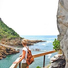 View of Storms River mouth  titsikamma. South Africa. Swing bridge. River mouth. Views. Leather backpack