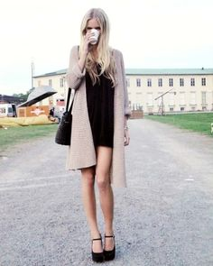 Love the short and risky black dress with the longer jacket look. :) Must find a long jacket and short black dress.