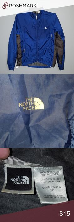 North Face Jacket 100% polyester, blue North Face jacket. Men's size small. Small white mark on right sleeve (seen in 5th photo) and small hole in back (seen in 6th photo). No other obvious flaws. North face Jackets & Coats Performance Jackets