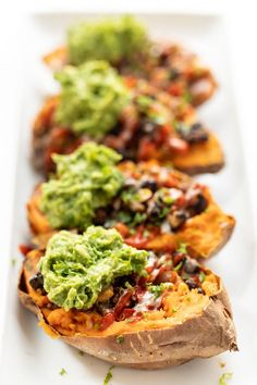 This recipe for Mexican Quinoa Stuffed Sweet Potatoes is an amazing way to pack in a ton of plant-based protein in a tasty gluten-free and simple meal! Simply Quinoa - March 16 2019 at Vegan Dinner Recipes, Vegan Dinners, Veggie Recipes, Mexican Food Recipes, Whole Food Recipes, Vegetarian Recipes, Cooking Recipes, Healthy Recipes, Gluten Free Yam Recipes