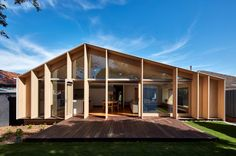 Timber fins shade asymmetric glazed gable added to Melbourne home by Warc Studio