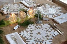 We got creative with burlap quite a bit this year, so when I saw this simple and all natural looking Christmas table at In My Own Style I got excited. Diane, the designer over there, is known for her gorgeous looks for less and this table is just one example of that impressive talent. Paper snowflakes lie beneath each setting's glass plates, while chunky glass votives in the center of the table bring a touch of icy elegance to the set up. So simple, yet so lovely!