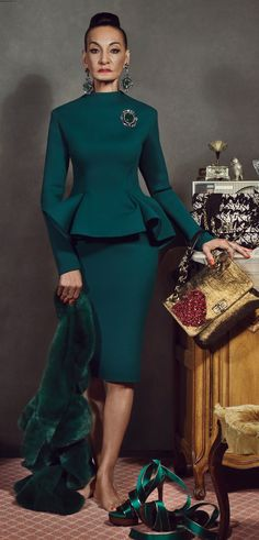 Jackie Tajah Murdock at 82-years-old was dressed in emerald green jacket and skirt from LANVINs Fall-Winter 2012 Collection