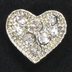Diamante love heart button set in silver base with stud back, $2.50 each. http://www.alacraft.com.au/diamante-love-heart-button-set-in-silver-base-with-stud-back-203    Button set in metal alloy base with silver finish. Use for embellishing everyday apparel, wedding dresses, shoes, bags, hair pieces, costumes and dance wear. Ideal for making jewellery such as rings, ear rings and brooches and for creating fancy brow bands for horses.