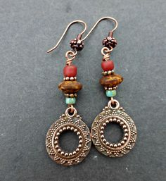 Copper metal detailed charms, Indonesian and Czech glass with copper ear wires. Handmade.