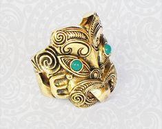 Large Brass and Turquoise Maori Ring. New Zealand born artist and designer. Maori Designs, Biker Rings, God Of War, Deities, Pendant Jewelry, Pop Culture, Cuff Bracelets, Pendants, Brass