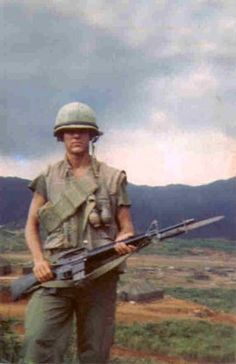 US Marine and his M16 with bayonet fixed.