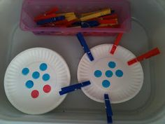 Kreative in Kinder: Math Centers!  bingo markers from dollar tree  1st  put 11 plates down with number cards under them 0-10 then let her put clothes pins on to match number to help fine motor skills