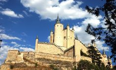 Segovia Castle, in the town of Segovia, rises out on a rocky crag above the confluence of the Eresma and Clamores rivers, near the Guadarrama Mountains in Spain. (From: Photos: Worlds Prettiest Castle Towns)