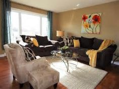 Basic layout like we discussed with artwork above the Sofa.  Add pillows/throw for color & warmth