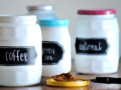 38 DIY organizing ideas for your home: Select glass jars in various sizes, spray paint them white to achieve a realistic porcelain look, and then paint the lids different colors to create great room accents. Use chalkboard paint to turn adhesive labels into miniature blackboards, and then write on the labels with a white crayon