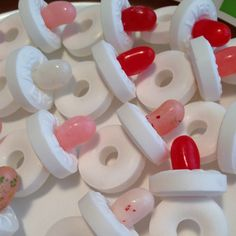 Pacifiers using life savers and jelly beans. Either lay them on a table for decoration or put a long piece of ribbon through it and use it as baby shower game.