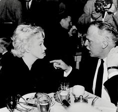 """Marilyn with director Joshua Logan at the Ram Restaurant, Sun Valley, Idaho, for a birthday dinner for co-star Arthur O'Connell during the production of """"Bus Stop"""", 1956."""