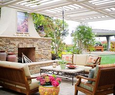 Outdoor Family Room. The spacious patio makes entertaining large gatherings of family and friends easy. Outdoor lighting also plays a vital role in keeping the party going well into the night. Downlights in the arbor are grouped by zone and fitted with dimmers, defining rooms within rooms. Plantings, stone lanterns, and a fountain at the yard's edge are softly lit, as well.