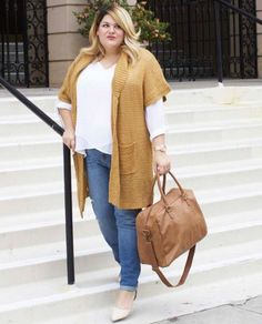 A white blouse under a caramel colored cardigan, paired with jeans, nude heels, and an oversized brown leather bag.