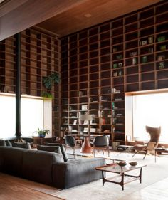 "Studio MK27 characterizes their design for this São Paulo penthouse as both ""cozy"" and ""solemn."" In the double-height library, custom…"