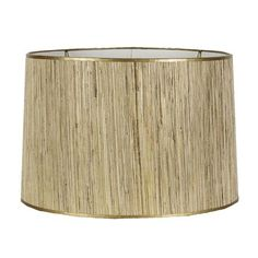 shades of light grasscloth and gold lampshade