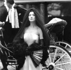 Elegant Spanish look, dress and black mantilla veil by Givenchy