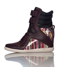 0c8e829acf57 REEBOK Alicia Keys High top women s wedge sneaker Lace up closure with  double velcro straps Cushioned