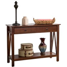 Display lush floral arrangements or serve cocktails and hora d'oeuvres with thisbrown console table, showcasinga lower shelf for added storage.