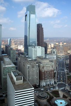 The old brick Curtis Publishing building is dwarfed  by the new Comcast Center.