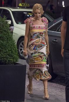 Stunning: Kylie Minogue showcased her petite frame in a colourful patterned minidress as she partied in Berlin with a group of friends over the weekend
