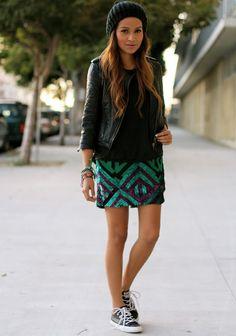 biker jacket, patterned skirt, and chucks.