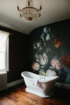 Dramatic wallpaper used as backdrop in bathroom.