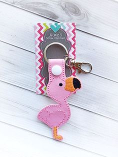 Get started on your Holiday shopping with this Flamingo key chain! Perfect gift or stocking stuffer! This Flamingo keychain comes in pink