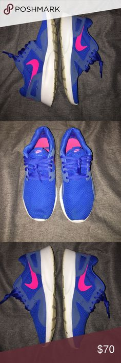 Nike tennis shoes Nike roshes- royal blue and hot pink. They have been worn but I keep my shoes in great condition. No marks on sides, only signs of wear are on the bottoms which is shown in the pictures! Size 8. Nike Shoes Athletic Shoes