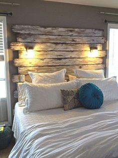 master bedroom with wood plank headboard