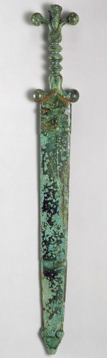 Sword, mid-1st century b.c.; Late Iron Age (La Tène) Celtic Iron blade, copper alloy hilt and scabbard.