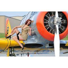 1940s style pin-up girl posing on a T-6 Texan training aircraft Canvas Art - Christian KiefferStocktrek Images (18 x 12)