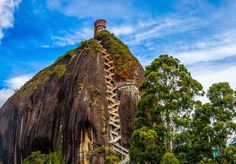 El Peñón de Guatapé is a massive rock located in the town and municipality of Guatapé, in Antioquia, Colombia.  Across this crack, is wedged a 649-step masonry staircase, that appears like a giant stitch holding the split rock together.