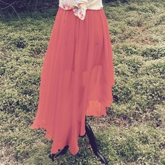 Full gathered Papaya flowy Skirt Color is between an orange and salmon color. Shorter skirt underneath the longer hi low flowing top layer. Flirty playful skirt perfect for those warm days. Preloved. Papaya Skirts High Low