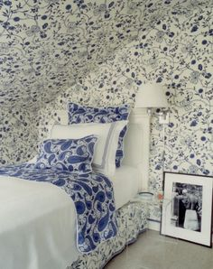 Todd Romano. So sweet, the best way to tackle an attic space, it blurs the lines...pretty blue and white.