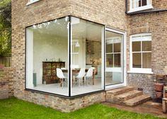 London house extension by Cousins and Cousins has a window wrapping its corner.