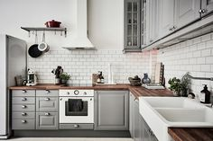 Stockholm Apartment with grey IKEA kitchen cabinets, white appliances, and gorge. Stockholm Apartment with grey IKEA kitchen cabinets, white appliances, and gorgeous dark wood butcher block countertops also from IKEA Grey Ikea Kitchen, Grey Kitchen Interior, Ikea Kitchen Cabinets, Grey Kitchens, Painting Kitchen Cabinets, Kitchen Cabinet Design, Kitchen Tiles, New Kitchen, Kitchen Countertops