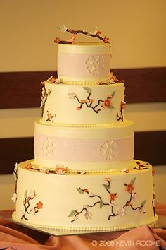 White cake with branchs and flowers, simple and gorgeous