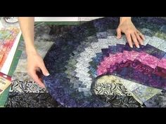 Spicy Spiral Table Runner with 9 Degree Wedge Ruler  the video didn't give you all the dimensions, or how to bind it.  They want you to buy the pattern