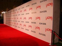 Red carpet backdrop for photos- make own with paper!!!!