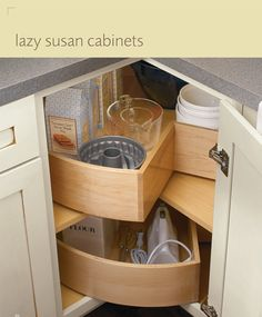 Love this lazy susan with deep walls to keep the items from falling off when spinning.  Kitchens for Less - Diamond Kitchen Cabinets